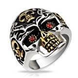 Skull ring with red stone.